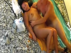 Making out naked on the beach