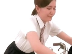 Wonderful Japanese gals wearing up skirts posing on a bikecycle