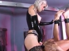 Tattooed Mistress pegging her slave boy