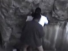 Guy fucks a black girl near rocks