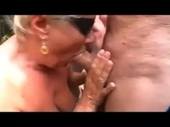 Granny sucking more cock at the beach