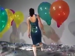 Sexy Girl In Latex Dress Blows to Pop Some Big Balloons