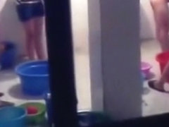 Voyeur peeps through the window of the girl's lockerroom