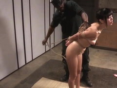 Asian submissive tormented with shibari