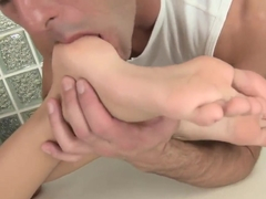 Erica Fontes has her feet massaged and sucked