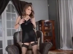 Voloptueus blonde in classy stockings toys herself