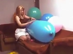 Riding a blue zeppelin shaped balloon till pop