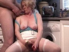 Inserting a sex toy in a mature bun