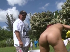Redhead milf starts playing with cock outside