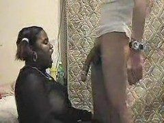 Ebony BBW gives a blowjob on video