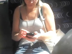 Upskirt sights of a girl texting in the bus