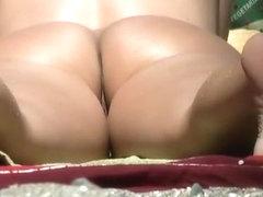 Nudist woman sunbathing crotch