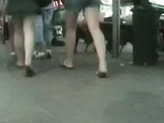 Voyeur vid of a thick white girl in a dark green skirt and thong
