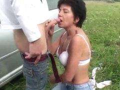 Mature slut fucks outdoors