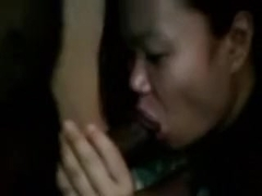 Thai angel blowing dark penis