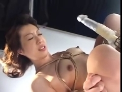 Asian bitch with oiled up tight body squirts on table