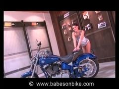 Naked gal touches bike erotically