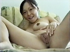 Petite Asian masturbates with comb