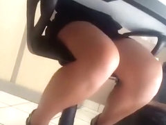 Teen co-worker upskirted under the table