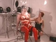 Red latex villein enjoys breath play