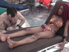 Ebony redhead has her feet licked by a humble white guy