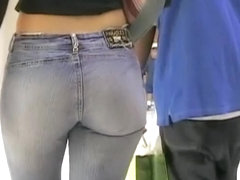 Amazing ass in blue jeans gets caught on camera
