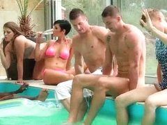 Bisexual couple has interracial groupsex poolside