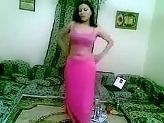 Nice-Looking brunette hair hair stomach dancer moves her body like a guru