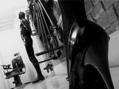 Brunette cruel mistress tortures a submissive male
