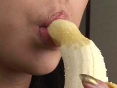Gorgeous Japanese hotty sexily eating a banana