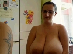 Nerdy slut shows her big round tits on veb chat