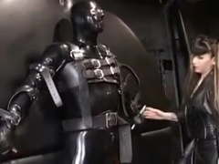Latex slave secured to the wall