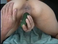 Playing with big cucumber