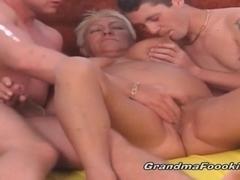 Slutty blonde granny satisfies two dudes