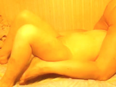 Fat mature woman sucks her husband's cock on the bed