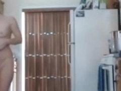 Nudist girl clean the kitchen
