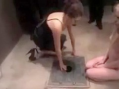 Bdsm head locked in gap in floor