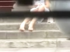 Girl sitting on the stairs and showing panty upskirt
