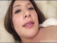 Concupiscent Emi Orihara in polka dots caresses her priceless mangos