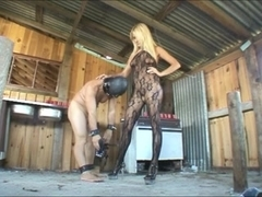 Fetish queen ravishes her slave.s ass with a strapon