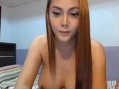 Sexy Filipina camgirl with fake tits DPs herself