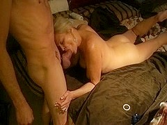 Mature broad in teabagging action