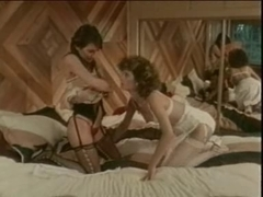 Vintage lesbian sex scene with two hot retro girls