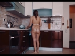 Sheela shows off her curves in the kitchen