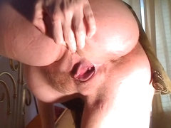 Drilling my preggo clit with a dildo