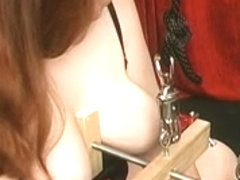 Bulky corseted redhead with biggest vagina lips receives her bazookas clamped hard and coarse