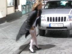 Wild blonde hussy masturbates in public