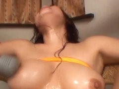 Rin Satomi Asian doll is tied and teased with dildos in