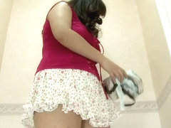 Spy cam in changing room shooting big naked titties