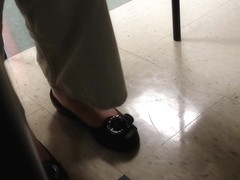 Shoe play under lunch table